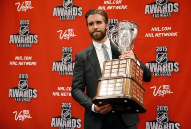 Florida Panthers' Aaron Ekblad poses with the Calder Memorial Trophy after winning the award at the NHL Awards show Wednesday, June 24, 2015, in Las Vegas. (AP Photo/John Locher)