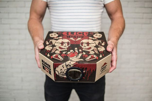 "Pizza Hut thinks it can do more than just bring food to your front door. It wants to deliver your entertainment for the evening, too. At least, that's the case in Hong Kong, where the pizza chain is delivering some pizzas in specially-designed boxes that convert into pseudo movie projectors. Designed by Ogilvy Hong Kong, the advertising stunt uses boxes with a perforated, pop-out hole in the side of the box. A very unique pizza table (also called a pizza protector) then serves as the projector's lens. Slip the plastic lens into the hole, and then use the pizza table's legs to prop up your smartphone inside the box. The contraption then blows up your phone's display onto any nearby wall. Even better, there are four different boxes, each of which comes with a separate movie download via a QR code. They're called Slice Night (for horror fans), Anchovy Armageddon (for science-fiction), Hot & Ready (for romance), and Fully Loaded (for an action flick). The box itself is fittingly called the ""Blockbuster Box."" Of course, you'll need a very dark room to be able to make out anything from the ""projector,"" and even then, the quality will still be pretty piss-poor. That's not to mention the fact that you'll probably get your phone all greasy by sticking it in that pizza box, and that you'll have to try to make out whatever muffled audio makes it through the walls of the pizza box. We're not letting that stop us from trying it out though — we just need to find a way to get to Hong Kong first."