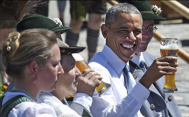 Enjoying beer and white sausages surrounded by men in lederhosen, Barack Obama looked perfectly at home as he tucked into a Bavarian breakfast over the weekend. But now the mayor of the picturesque Alpine village of Kruen has revealed that the U.S. president's order was somewhat less traditional than it looked - including a non-alcoholic wheat beer. Eyebrows were raised when, having just stepped off of a night flight from the U.S., Obama was photographed at 11am enjoying half a litre of weissbier - the customary accompaniment to the local hearty breakfast of pretzels and minced veal and bacon sausages. His claim to authenticity took something of a pounding a few hours later, however, when local mayor Thomas Schwarzenberger told reporters that the beer Obama and those accompanying him were served actually contained no alcohol.