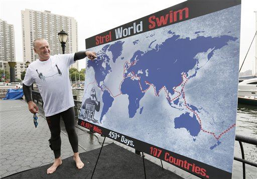 "(NEWSER) – Martin Strel swims with a knife strapped to his right leg—in case he encounters sharks, ""vampire"" fish, and other deadly marine life in the world's wildest waters. Yesterday, the 60-year-old marathon swimmer from Phoenix announced the toughest feat of his life: a 10,000-mile around-the-world voyage on water to draw public attention to increasing aquatic pollution. ""And for peace and love,"" Strel added in his native Slovenian. He aims to circle the globe in about 450 days, starting in Long Beach, Calif., on March 22 and passing through oceans, rivers, canals, and other bodies of water in more than 100 countries. He'll swim about five to 12 hours each day, depending on the weather and changing currents; an escort boat will offer emergency support and space for small breaks. Since 2000, Strel has swum the entire length of five rivers—the piranha-infested Amazon, the Danube in Eastern Europe, China's Yangtze, the Parana in South America, and the Mississippi, earning him the nickname ""Big River Man."" On his South American swims, he watches out for the candiru, the ""most dangerous fish on the planet"" (it bores into every human cavity and grows by feeding on human flesh and blood); says piranhas ""are OK""; and isn't freaked out by sharks, which he says leave him alone if he swims in the same direction as them and doesn't confront them. He's still finalizing details of his adventure, a multimillion-dollar jaunt that will once more include the Panama and Suez canals, the English Channel, and the Amazon, as well as the Atlantic and Pacific oceans and the Red Sea. Strel says he welcomes anyone who's interested to join him for stretches of the route."