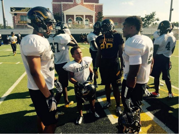 """Adam Reed just wants to be one of the guys on Plantation American Heritage's nationally ranked football team. If you watched what happened after last Saturday's 36-8 romp over Stephenson (Ga.) at the Battle of the Borders Classic in Atlanta, the Patriots' 4-5, 95-pound, fifth-string running back seems to be fitting in just fine. He had about as many fans wanting to snap pictures with him as his highly recruited teammates. """"I'm a little undersized,"""" the 17-year-old senior said Tuesday after practice. """"But it's, whatever. I don't let my size stop me from doing anything."""" It's one thing to be undersized and playing in a local recreational league or on the junior varsity squad. It's an entirely different thing to run with the varsity team of the school's back-to-back Class 5A state championship squad and earn the respect of teammates and coaches. Reed has. After playing on the middle school and junior varsity teams at Heritage since the sixth grade, Reed began his senior year last month ineligible for the JV squad because of his age and year in school. If he was going to play football, he had to make the varsity team. And he did, impressing coach Mike Rumph by attending every offseason meeting, workout and practice alongside the biggest player on the team (6-6, 338-pound junior All-American offensive lineman Tedarrell Slaton) and the second-smallest (5-8, 146-pound junior receiver Jason Heinstkill). """"It's special to see somebody that diminutive, being dealt a tough hand, coming out here and working just like any other person,"""" said Patrick Surtain, Heritage's defensive coordinator and a former Dolphins Pro Bowl cornerback. """"We don't even look at Adam like that because he's Adam to us, because he puts in the work like everybody else. He doesn't want anything handed to him. He wants to earn it. And so far he has. It's good to have somebody like that on your team."""" Reed, who played on the junior varsity at Heritage alongside Surtain's son Patrick Jr., a 6-1, 175-pound soph"""