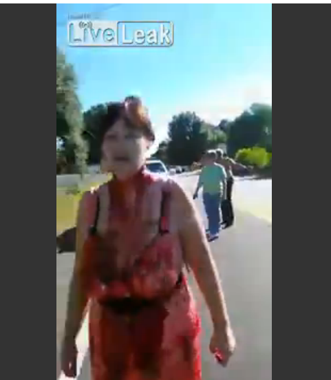 Woman walks Down Street With A huge Cut In Her Neck, Ignores Pleas From Passers By To Stop. Pensacola, FL 9/25/2015 [credit: James Smith / licensing@viralhog.com] VIDEO LINK HERE ----> http://www.liveleak.com/view?i=b97_1443283096#YhQLltSqCjBQpyLd.99