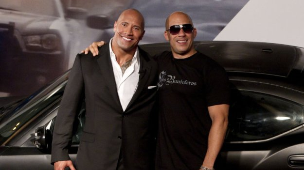 "The feud between Dwayne 'The Rock' Johnson and Vin Diesel not only rages on, but is getting even more heated as filming for the upcoming Fast 8 film comes to a close. Previous reports claim that Johnson, who called his fellow male actors ""candy asses"", and Diesel were arguing over decisions the latter made that didn't sit well with 'The Rock.' Earlier this month, anonymous sources claimed the two had met to squash their beef, putting an end to their quarreling. The latest tidbit of news, though, muddles the waters even more – the actors were likely never really fighting. According to Life & Style Magazine, the feud between Johnson, who plays Luke Hobbs, and Diesel, who will reprise his role as Dominic Toretto, was a hoax. An anonymous source told the outlet that the feud between the two was a stunt to get people aroused for a WWE wrestling match and to promote the Fast 8 film. The source claims the stunt was Johnson's idea. After all, the star first got his start in wrestling. While the report sounds like it's coming out of left field – partly because it is – it sort of makes sense. Johnson's movie career involves numerous films with other actors that were probably difficult to work with and the actor has never voiced any negative words towards another actor. At least not in the way he did towards Diesel. On the other hand, if the fake feud is being used to garner attention, the actors aren't taking it far enough. Wouldn't there be more rants aimed at one another? Something doesn't add up and, if you ask us, we think the hatred between the two is real. The anonymous source may be trying to cover up the real conflict between the actors. Either way, a wrestling match between 'The Rock' and Diesel would be huge for both the film and WWE. Only time will tell if Johnson and Diesel really settle their anger in the ring, but if they do, our money's on 'The Rock.'"