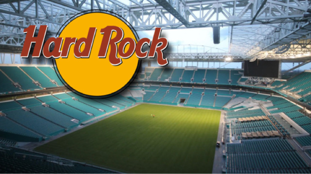 MIAMI GARDENS, Fla. - Who knows if the Dolphins will win this season, but they'll definitely rock. According to a report, the Dolphins will announce that their newly renovated home will be known as Hard Rock Stadium. More Dolphins Headlines     (@TomGarfinkel / Twitter) Grass installed at Dolphins renovated stadium     Hurricanes scheduled to open season at Dolphins' stadium as construction… Andy Slater reports the announcement could come as soon as Wednesday and that the trademark was applied for last week. The former Joe Robbie Stadium, Pro Player Park, Pro Player Stadium, Dolphins Stadium, Dolphin Stadium, Land Shark Stadium and, most recently, Sun Life Stadium has been looking for a new name since the Sun Life Financial rights expired earlier in 2016. The stadium had been temporarily titled New Miami Stadium. A new roof adorns the renovated stadium, giving shade to Dolphins and Hurricanes fans on hot game days. The stadium will debut its makeover when the University of Miami opens its season Sept. 3 vs. Florida A&M.